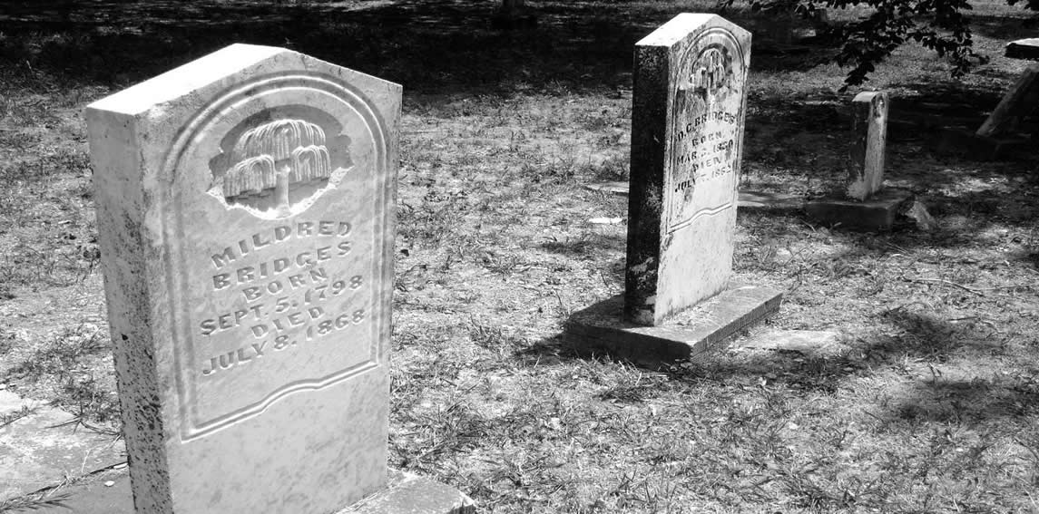 Black and white photo of grave monuments